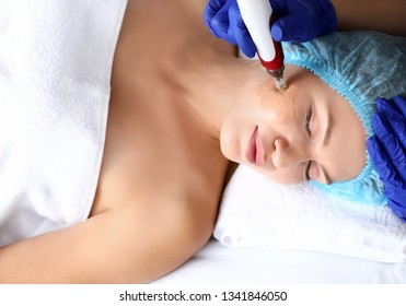 Young woman undergoing procedure of bb glow treatment in beauty salon - Shutterstock ID 1341846050