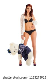 Young woman in underwear with toy bears