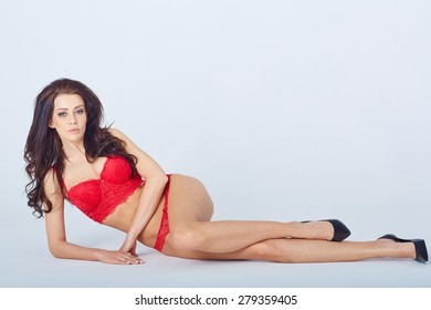 Young woman in underwear in a white studio