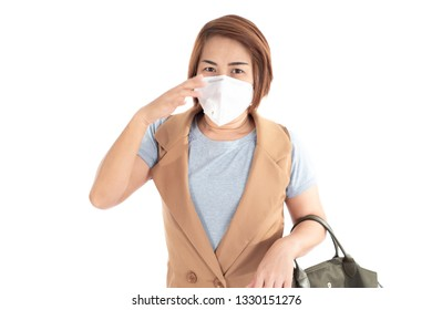 Young woman use a mask to protect air polution on white background.