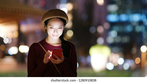 Young woman use of mobile phone in the street