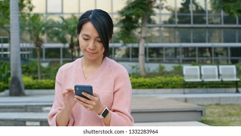Young woman use of mobile phone at outdoor