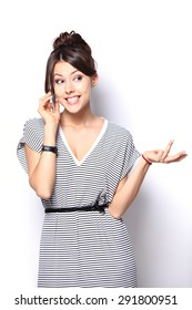 Young Woman Using a Cell Phone Isolated on White