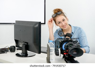 a young woman using computer for video editing