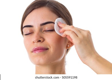 Young woman using cotton pads