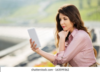 Young woman using a digital tablet computer