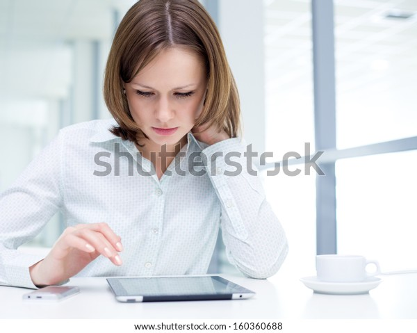 Young woman using a digital tablet