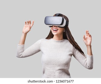 Young woman using glasses of virtual reality. VR, future, gadgets, technology concept