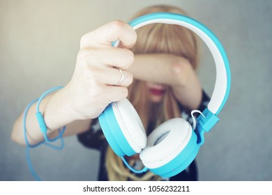 Young woman using her headphones