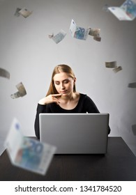 Young woman using a laptop to browse the net. Young woman in black and falling Euro banknotes. Currency and job concept.