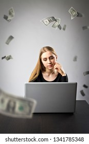 Young woman using a laptop to browse the net. Young woman in black and falling dollar banknotes. Currency and job concept.
