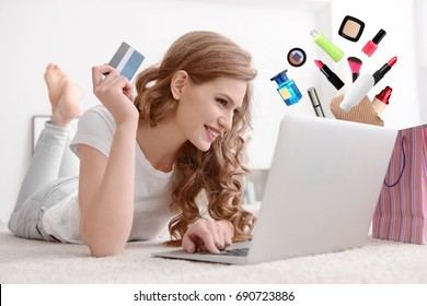 Young woman using laptop for browsing internet store at home. Online shopping concept