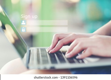 Young woman using laptop computer and sign up or log in username password in coffee shop,GDPR.cyber security and privacy concept