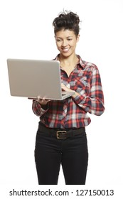 Young woman using laptop on white background smiling