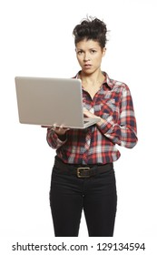 Young woman using laptop on white background looking confused