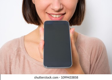 Young woman using phone vocal assistant isolated on white background