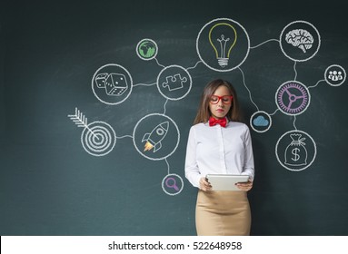 Young woman using smart phone with social media text and icon on the blackboard