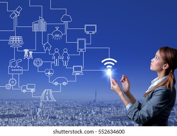 young woman using smart phone and wired various wireless communication devices