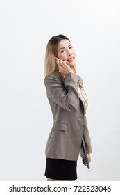 Young woman using smart phone on white background