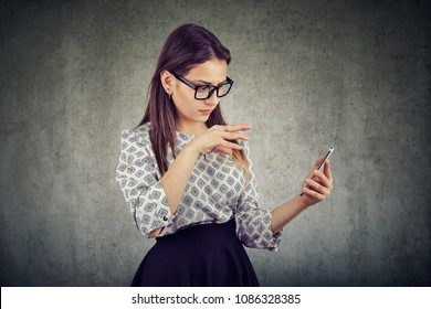 Young woman using a smartphone manipulating social media content