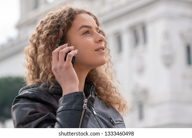 Young woman using smartphone in Rome, Italy