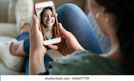 Young woman using smartphone for video call