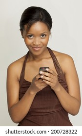 Young woman using social media on her mobile phone.