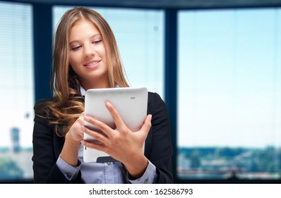 Young woman using a tablet in her office