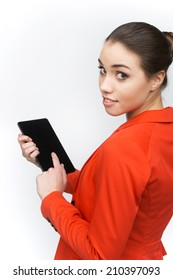 Young woman using touch pad on white background. Over shoulder view of woman holding tablet and looking back