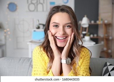 Young woman using video chat at home