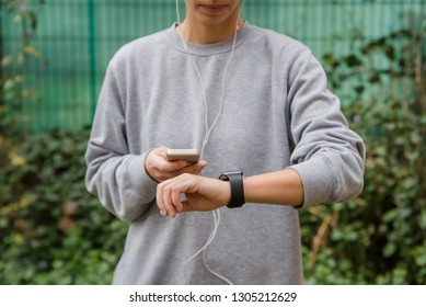 Young woman using wearable tech during fitness workout