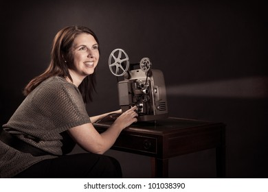 Young Woman Viewing Movies on Old Projector