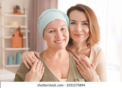 Young woman visiting her mother with cancer indoors