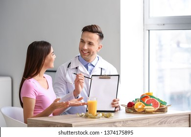 Young woman visiting nutritionist in weight loss clinic