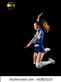 Young woman volleyball player isolated on black