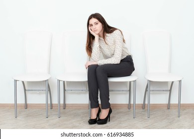 Young woman in waiting room being bored