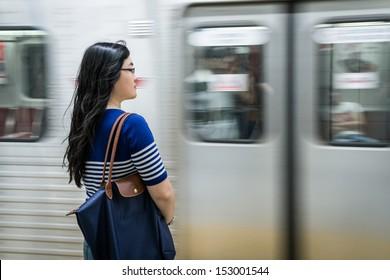 Young woman waiting at subway station