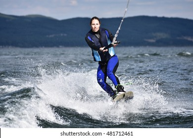 Young woman Wakeboarding, kite surf as extreme and fun sport