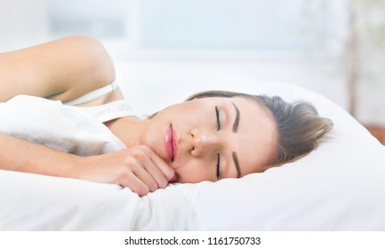 Young woman wakeup after sleeping on the