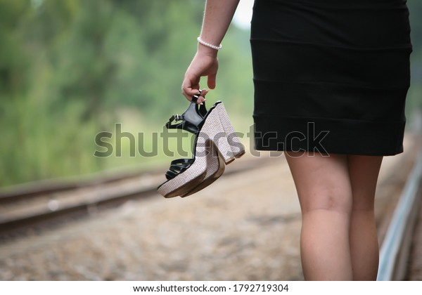 young-woman-walking-along-set-600w-17927