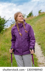 Young woman walking with hiking poles