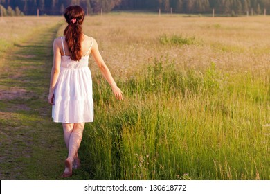 Young woman walking in nature.