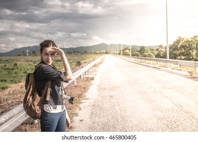 Young woman walking on a country road, vintage