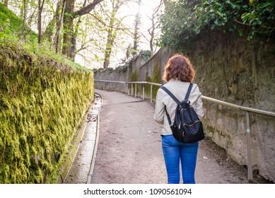 Young woman is walking on a path to the Ljubljana castle in Ljubljana, Slovenia