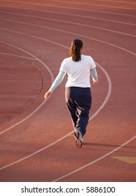 Young woman walking on Track for exercise