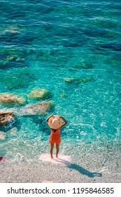young woman walking at pebble beach Monterosso on vacation Cinque terre Monterosso al Mare pebble beach Cinque Terre, Italy