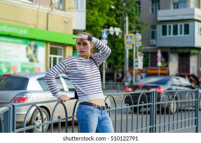 Young woman walking and resting on the street