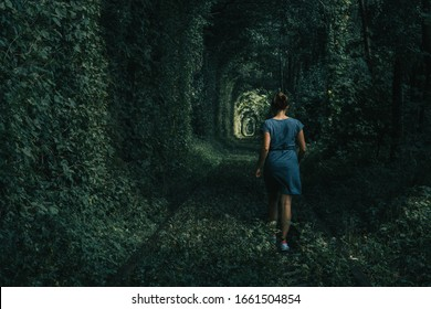 Young woman walking through the tunnel of love in Orzhiv, Ukraine.