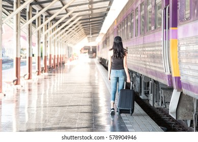 young woman is walking train station