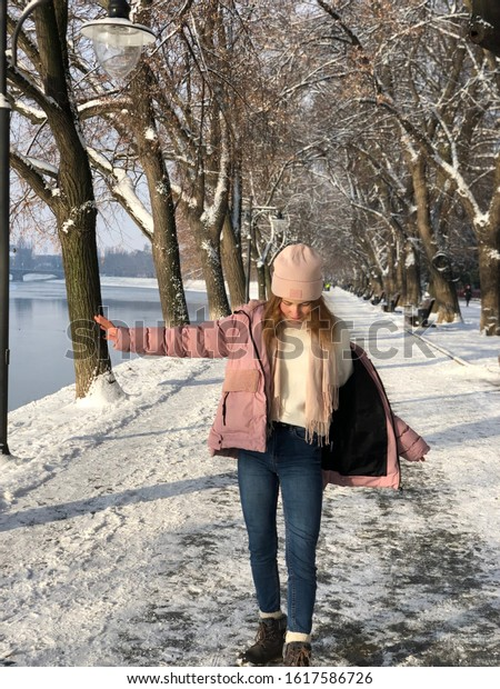 Young woman is walking, Winter background, River view